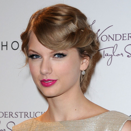 9. taylor swift sagittarius bright pink